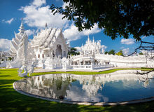 White Temple in northern Thailand. Wat Rong Khun White Temple with reflection in the pond in Chiang Rai, Thailand Royalty Free Stock Photo