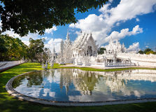 White Temple in northern Thailand. Wat Rong Khun The White Temple with reflection in the pond in Chiang Rai, Thailand Royalty Free Stock Photography