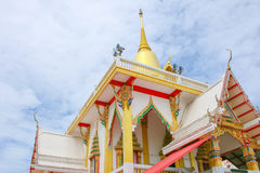 White temple and top gold pagoda on blue sky background Stock Image