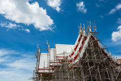 White temple under construction. On blue sky stock image