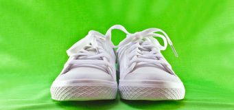 Tennis shoes. A closeup of white leather tennis shoes stock photos