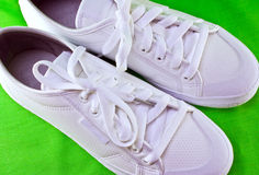 White tennis shoes. A closeup of white leather tennis shoes stock photo