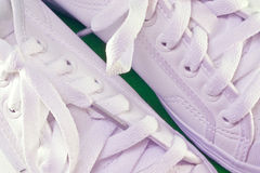 Tennis shoes. A closeup of white leather tennis shoes royalty free stock images