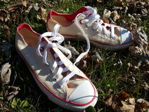 White tennis shoes in grass Stock Photo