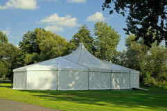 White tent. White circus or party tent in a public park Stock Photo