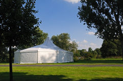 White tent. White circus or party tent in a public park Royalty Free Stock Images
