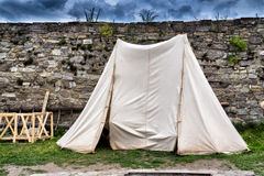 White tent on the ancient walls and background Stock Photo