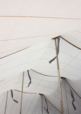 White Tent Ceiling Interior With Gold Poles and Flag Shadows. An upward view of a large white event tent accented by gold-tone support poles and the shadows of Royalty Free Stock Photography