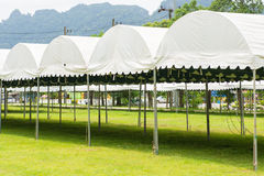 White tent in a green field Royalty Free Stock Photos