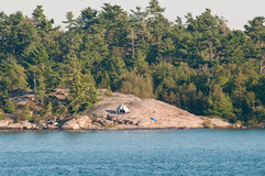 White tent on rocky island Royalty Free Stock Images