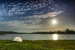 White tent, sun and clounds Stock Photos