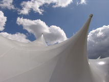 White tent tops. Tops of white tents against blue sky stock photo