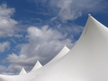 White tent tops. Tops of white tents against blue sky royalty free stock images