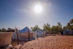 White tents in the camp of the desert Lompoul, Senegal, Africa. The sun is shinning on the sand. There is beautiful blue sky, landscape, nature, travel royalty free stock images