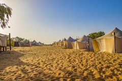 White tents in the camp of the desert Lompoul, Senegal, Africa. There is beautiful blue sky landscape nature sand travel tourism outdoor adventure dunes summer royalty free stock image