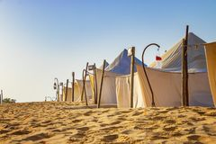 White tents in the camp of the desert Lompoul, Senegal, Africa. There is beautiful blue sky, landscape, nature, sand, travel, tourism, outdoor, adventure stock photography