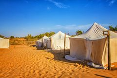 White tents in the camp of the desert Lompoul, Senegal, Africa. There is beautiful blue sky, landscape, nature, sand, travel, tourism, outdoor, adventure stock image