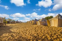 White tents in the camp of the desert Lompoul, Senegal, Africa. There is beautiful blue sky landscape nature sand travel tourism outdoor adventure dunes summer royalty free stock photos