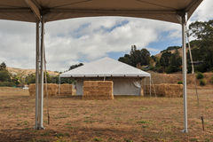 White tents in a dry field outdoors Royalty Free Stock Photo