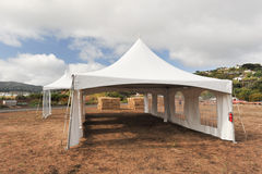White tents in a dry field outdoors Royalty Free Stock Image