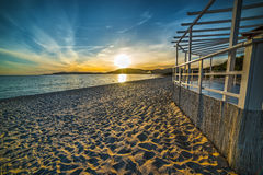 White terrace by the sea at sunset Stock Photography