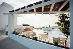 Terrace with swimming pool on the island of Santorini royalty free stock photos