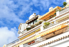 White terraced house facade in orange and yellow in Mijas Malaga, Spain Stock Image