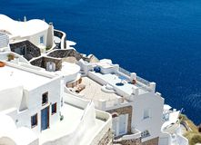 White terraces. With cozy terraces of Santorini offer a view of the sea Royalty Free Stock Photo