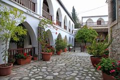 White terraces and flowerpots in courtyard of St Minas Monastery. View with white arch terraces and flowerpots in courtyard of St Minas Monastery, Cyprus stock photo