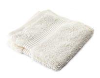 White terry towel. On a white background Stock Photo