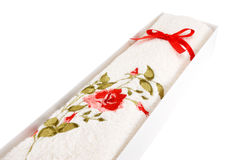 White terry towel. With a bow on a white background Royalty Free Stock Image