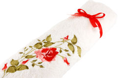 White terry towel. With a bow on a white background Stock Photography