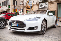 White Tesla model S car parked on urban roadside. Rome, Italy - February 13, 2016 : White Tesla model S car parked on urban roadside in Rome royalty free stock image