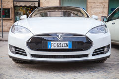 White Tesla model S car parked on urban roadside. Rome, Italy - February 13, 2016 : White Tesla model S car parked on urban roadside in Rome, front view, closeup royalty free stock photography