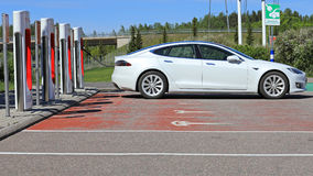 White Tesla Model S Electric Car Charging Battery stock images