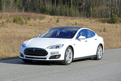 White Tesla Model S Electric Car on the Road Royalty Free Stock Photo