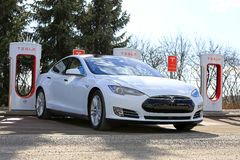 White Tesla Model S P85D Plugged on Supercharger Stock Photography