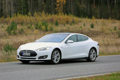 White Tesla Model S on the Road in October stock photo