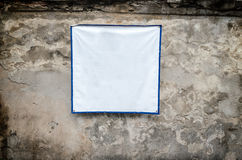 White Textile Banners on old plaster walls Stock Images