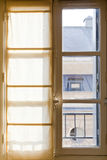 Textile drapes on sunny window Stock Photo
