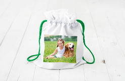 White textile gift bag with colorful print Stock Image