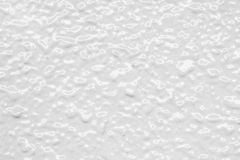 White Texture. A white textured, smooth and wet stucco decorates a wall and serves as a background royalty free stock photography
