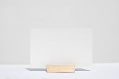 White texture blank name card. On wood stand Stock Image
