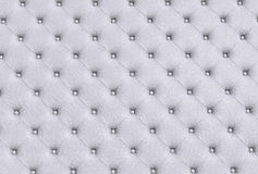 The white texture of the skin quilted sofa Stock Photos