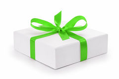 White textured gift box with green ribbon bow Stock Photography