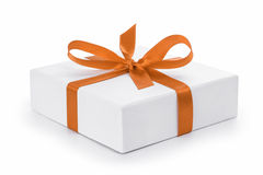 White textured gift box with orange ribbon bow Stock Photography