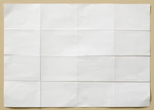 White textured sheet of paper folded in sixteen  part Royalty Free Stock Images