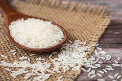 White Thai jasmine rice on wooden plank Stock Photos