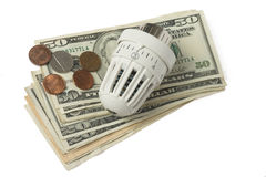 White thermostat and money Royalty Free Stock Image