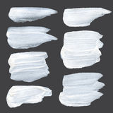 White thick paint strokes on a dark surface Royalty Free Stock Photos